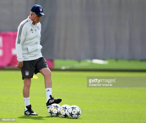 Bayern Munich's German head coach Jupp Heynckes prepares the balls during a training session at the trainings ground of FC Bayern Munich in Munich...