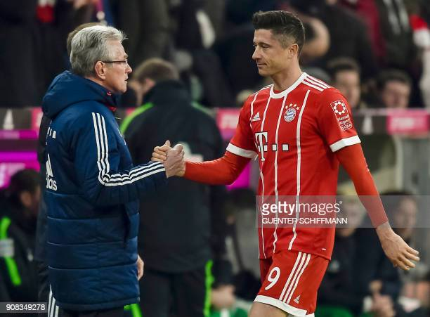 Bayern Munich's German head coach Jupp Heynckes shakes hands with Polish striker Robert Lewandowski as he leaves the pitch during the German first...