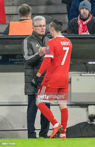 Bayern Munich's German head coach Jupp Heynckes thanks Bayern Munich's French midfielder Franck Ribery during the UEFA Champions League football...