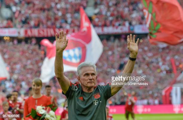 Bayern Munich's German head coach Jupp Heynckes waves good bye to the fans as he arrives for his last match as Munich's coach prior to the German...
