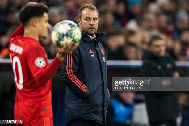 Bayern Munich's German interim head coach HansDieter Flick watches Bayern Munich's Brazilian midfielder Philippe Coutinho preparing for a throw in...