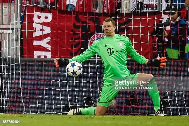 Bayern Munich's German keeper Manuel Neuer makes a save during the UEFA Champions League 1st leg quarterfinal football match FC Bayern Munich v Real...