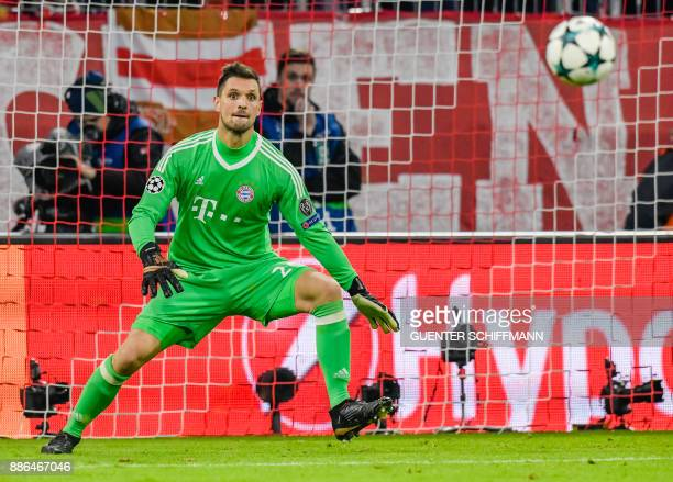 Bayern Munich's German keeper Sven Ulreich eyes the ball during the UEFA Champions League football match between Paris SaintGermain and Bayern Munich...