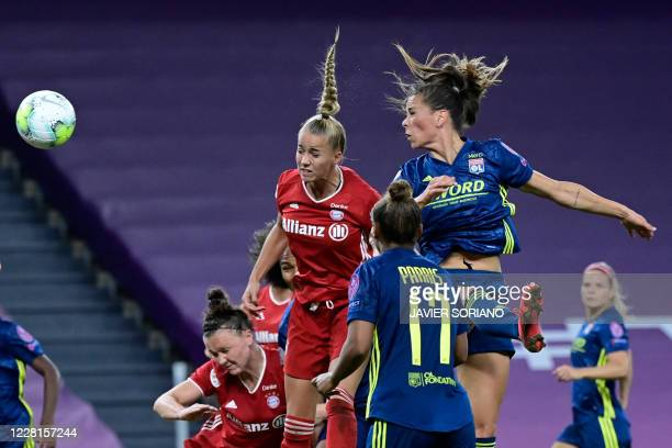 Bayern Munich's German midfielder Giulia Gwinn vies with Lyon's Icelandic midfielder Sara Bjork Gunnarsdottir during the UEFA Women's Champions...