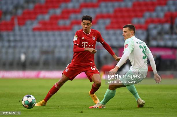 Bayern Munich's German midfielder Jamal Musiala and Bremen's German midfielder Maximilian Eggestein vie for the ball during the German first division...