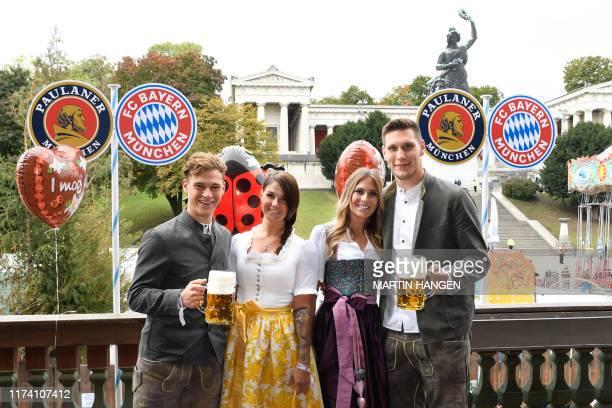 Bayern Munich's German midfielder Joshua Kimmich and his girlfriend Lina Meyer and Bayern Munich's German defender Niklas Suele and his girlfriend...