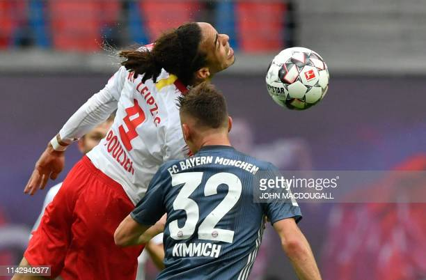 TOPSHOT Bayern Munich's German midfielder Joshua Kimmich and Leipzig's Danish forward Yussuf Poulsen vie for the ball during the German first...