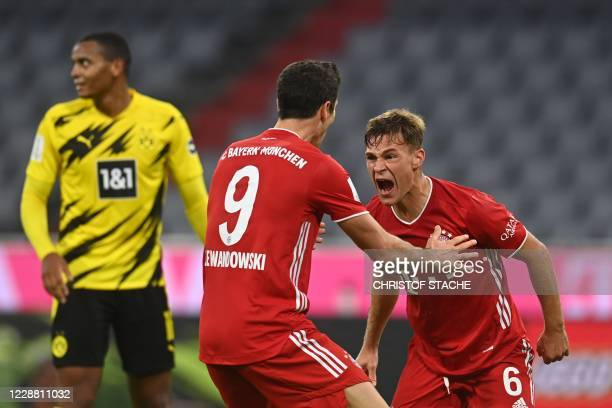 TOPSHOT Bayern Munich's German midfielder Joshua Kimmich celebrates scoring 32 with Bayern Munich's Polish forward Robert Lewandowski during the...