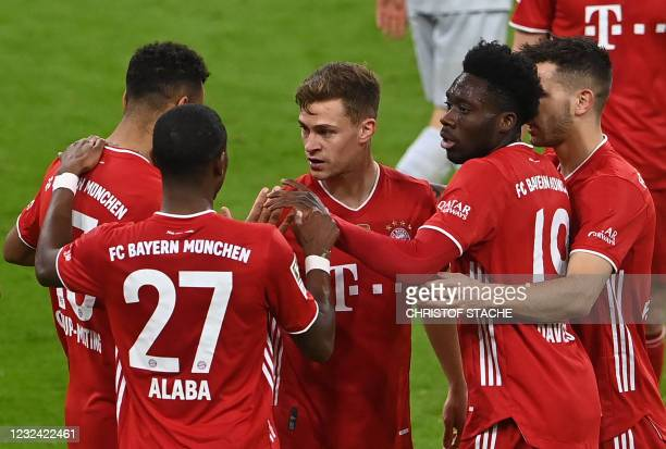 Bayern Munich's German midfielder Joshua Kimmich celebrates with teammates after scoring the 2-0 goal during the German first division Bundesliga...