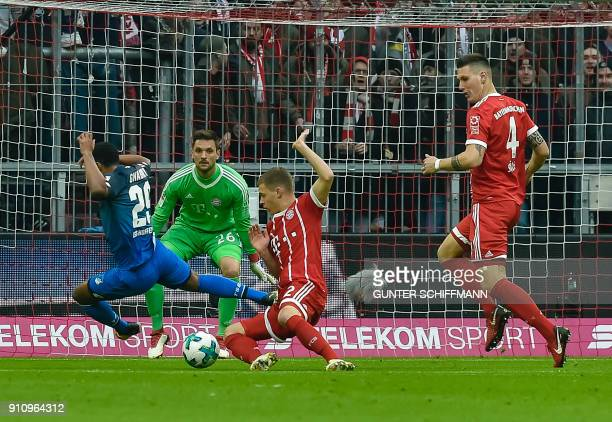 Bayern Munich's German midfielder Joshua Kimmich fouls Hoffenheim's German forward Serge Gnabry during the German first division Bundesliga football...