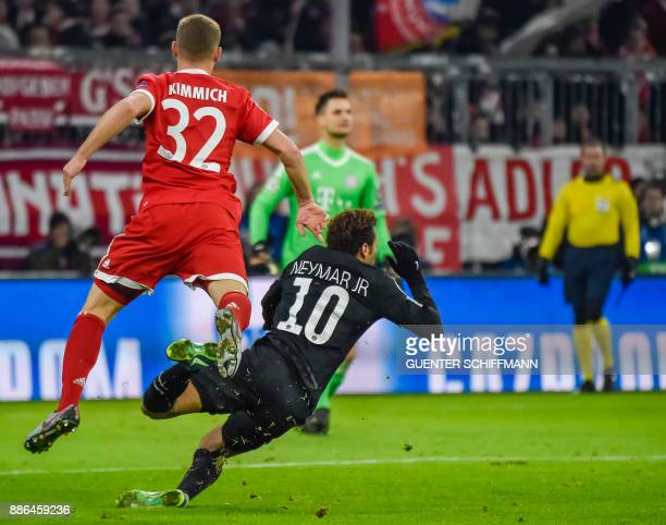 Bayern Munich's German midfielder Joshua Kimmich fouls Paris SaintGermain's Brazilian striker Neymar during the UEFA Champions League football match...
