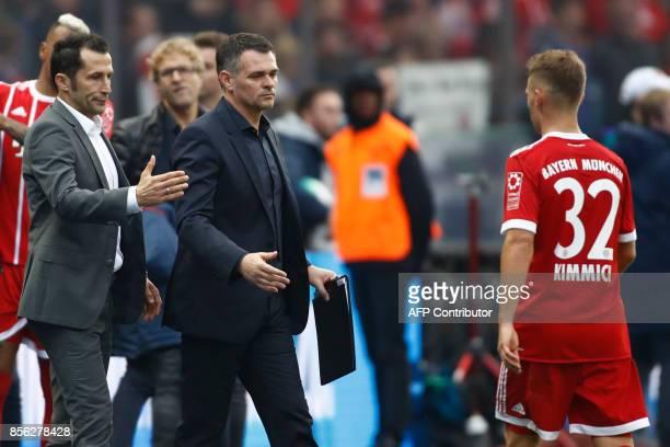Bayern Munich's German midfielder Joshua Kimmich is greeted by Bayern Munich's Bosnian sporting director Hasan Salihamidzic and Bayern Munich's...