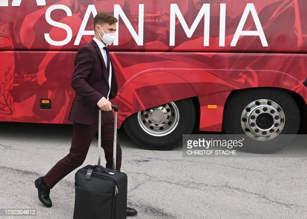 Bayern Munich's German midfielder Joshua Kimmich leaves the airport upon arrival in Munich, southern Germany, on April 14, 2021 as the FC Bayern...