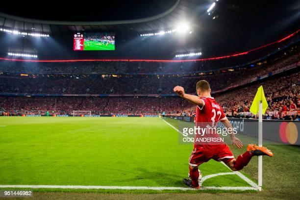 Bayern Munich's German midfielder Joshua Kimmich plays a corner kick during the UEFA Champions League semifinal firstleg football match FC Bayern...