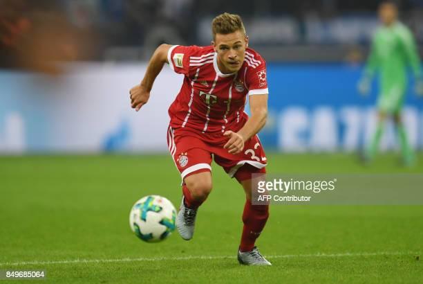 Bayern Munich's German midfielder Joshua Kimmich plays the ball during the German First division Bundesliga football match between FC Schalke 04 and...