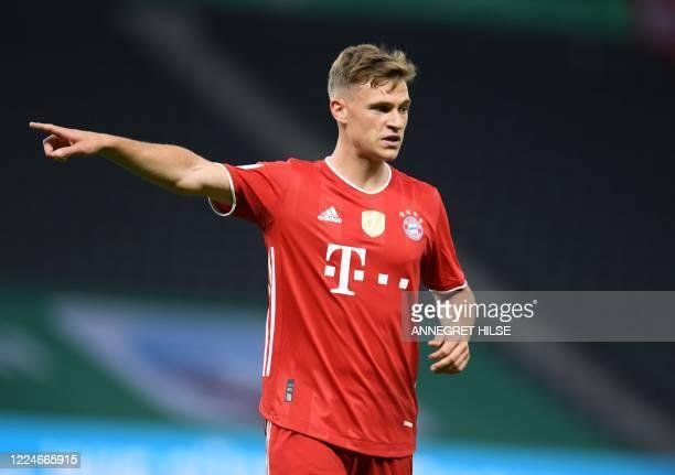 Bayern Munich's German midfielder Joshua Kimmich reacts during the German Cup final football match Bayer 04 Leverkusen v FC Bayern Munich at the...