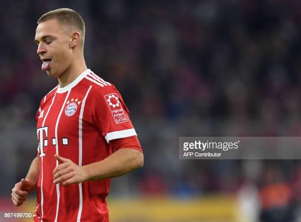 Bayern Munich's German midfielder Joshua Kimmich reacts during the German First division Bundesliga football match Bayern Munich vs RB Leipzig in...