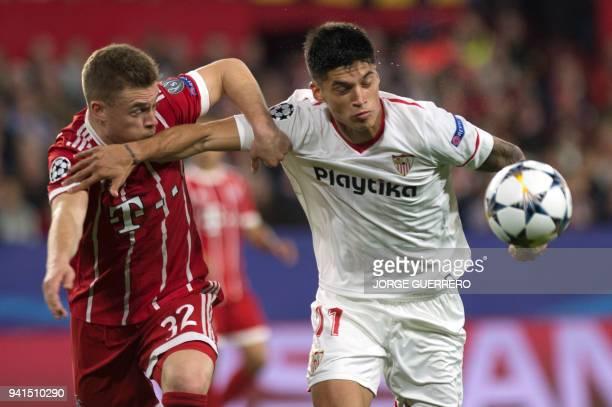 Bayern Munich's German midfielder Joshua Kimmich vies with Sevilla's Argentinian midfielder Joaquin Correa during the UEFA Champions League...