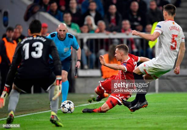 Bayern Munich's German midfielder Joshua Kimmich vies with Sevilla's French defender Clement Lenglet during the UEFA Champions League quarterfinal...