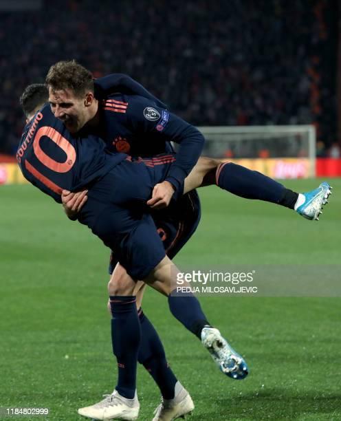 Bayern Munich's German midfielder Leon Goretzka celebrates scoring his team's first goal with his teammate Bayern Munich's Brazilian midfielder...