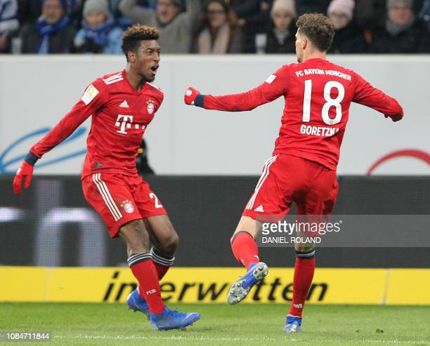 Bayern Munich's German midfielder Leon Goretzka celebrates scoring the opening goal with his teammate French forward Kingsley Coman during the German...