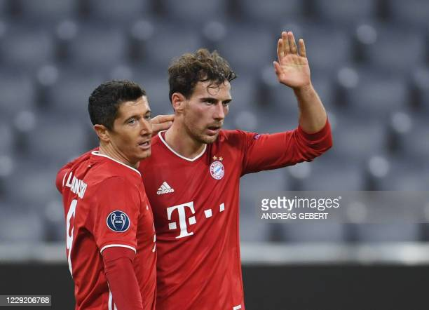 Bayern Munich's German midfielder Leon Goretzka celebrates scoring the 20 goal with his teammate Polish forward Robert Lewandowski during the UEFA...