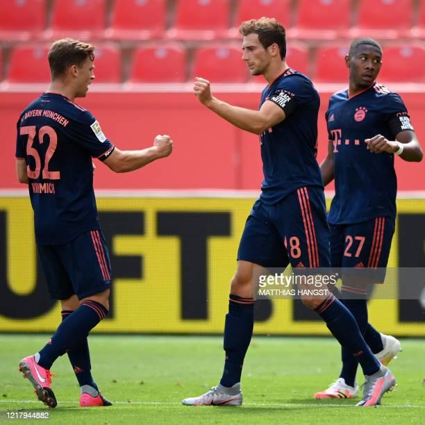 Bayern Munich's German midfielder Leon Goretzka celebrates with Bayern Munich's German midfielder Joshua Kimmich and Bayern Munich's Austrian...