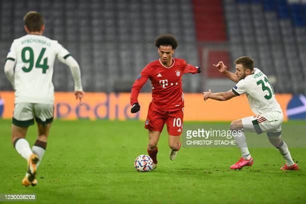 Bayern Munich's German midfielder Leroy Sane and Lokomotiv Moscow's Polish midfielder Maciej Rybus vie for the ball during the UEFA Champions League...