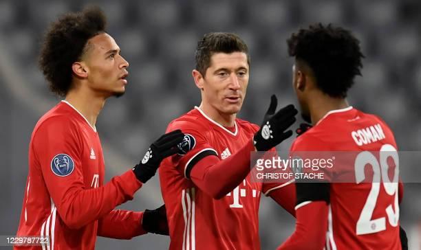 Bayern Munich's German midfielder Leroy Sane, Bayern Munich's Polish forward Robert Lewandowski and Bayern Munich's French forward Kingsley Coman...