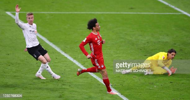 Bayern Munich's German midfielder Leroy Sane celebrates after scoring the 6-0 against Moenchengladbach's Swiss goalkeeper Yann Sommer during the...