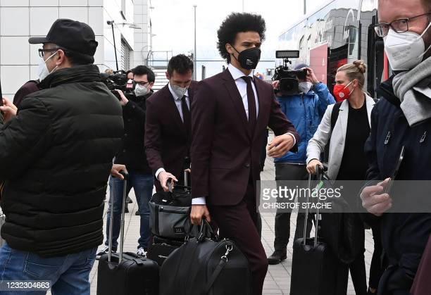 Bayern Munich's German midfielder Leroy Sane leaves the airport upon arrival in Munich, southern Germany, on April 14, 2021 as the FC Bayern Munich...