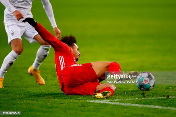 Bayern Munich's German midfielder Leroy Sane vies for the ball during the German first division Bundesliga football match Borussia Moenchengladbach v...