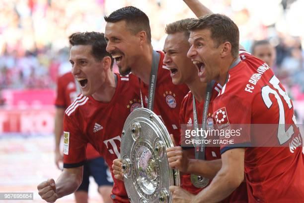 Bayern Munich's German midfielder Sebastian Rudy forward Sandro Wagner German midfielder Joshua Kimmich and German forward Thomas Mueller pose with...