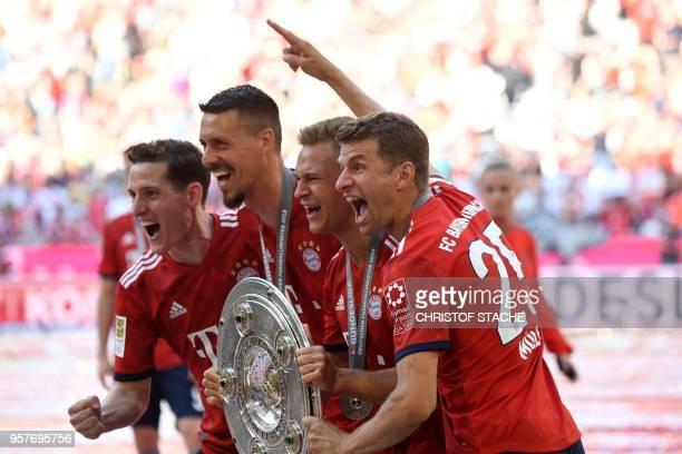TOPSHOT Bayern Munich's German midfielder Sebastian Rudy forward Sandro Wagner German midfielder Joshua Kimmich and German forward Thomas Mueller...
