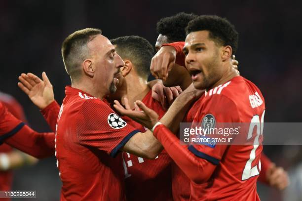 Bayern Munich's German midfielder Serge Gnabry and his teammates including French midfielder Franck Ribery celebrate equalising during the UEFA...