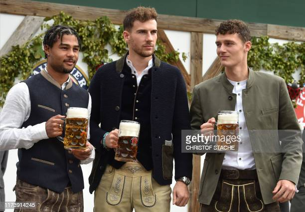 Bayern Munich's German midfielder Serge Gnabry Bayern Munich's German midfielder Leon Goretzka and Bayern Munich's French defender Benjamin Pavard...