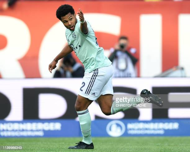 Bayern Munich's German midfielder Serge Gnabry celebrate scoring during the German first division Bundesliga football match Nuremberg v FC Bayern...