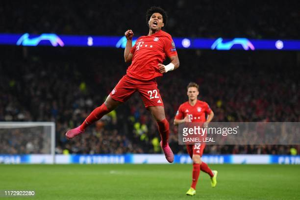 TOPSHOT Bayern Munich's German midfielder Serge Gnabry celebrates after scoring their third goal during the UEFA Champions League Group B football...
