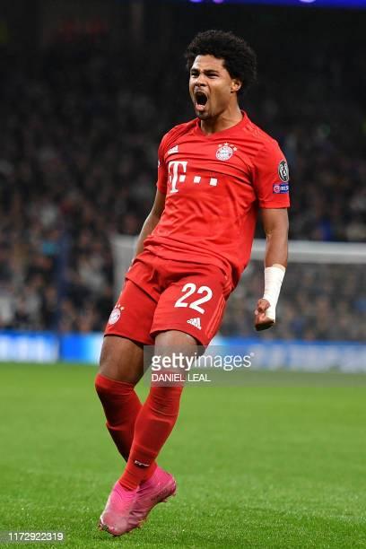 Bayern Munich's German midfielder Serge Gnabry celebrates after scoring their third goal during the UEFA Champions League Group B football match...