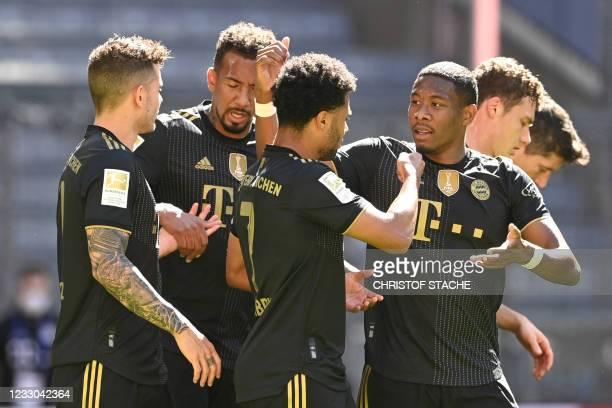 Bayern Munich's German midfielder Serge Gnabry celebrates scoring his team's second goal with Bayern Munich's Austrian defender David Alaba and team...
