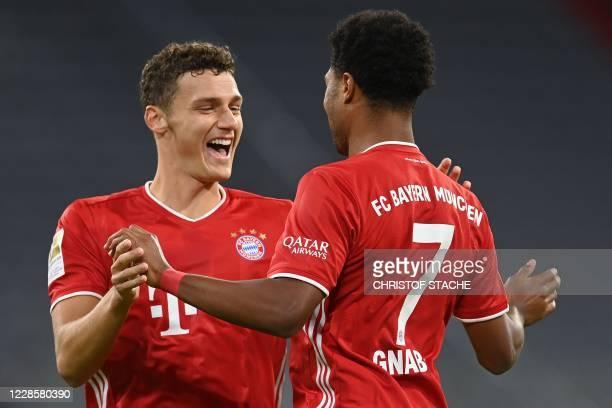 Bayern Munich's German midfielder Serge Gnabry celebrates scoring with his teammate Bayern Munich's French defender Benjamin Pavard during the German...