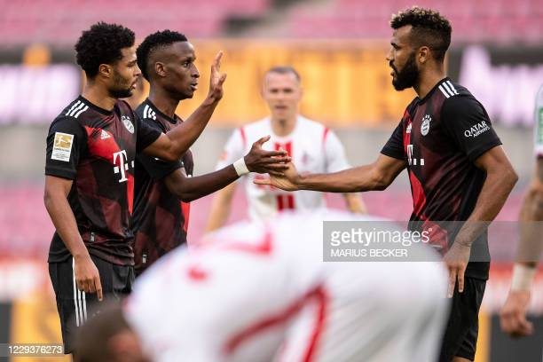 Bayern Munich's German midfielder Serge Gnabry celebrates scoring with Bayern Munich's French defender Bouna Sarr and Bayern Munich's Cameroonian...