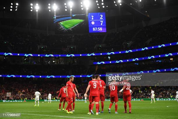 Bayern Munich's German midfielder Serge Gnabry celebrates with teammates after scoring their seventh goal his fourth during the UEFA Champions League...