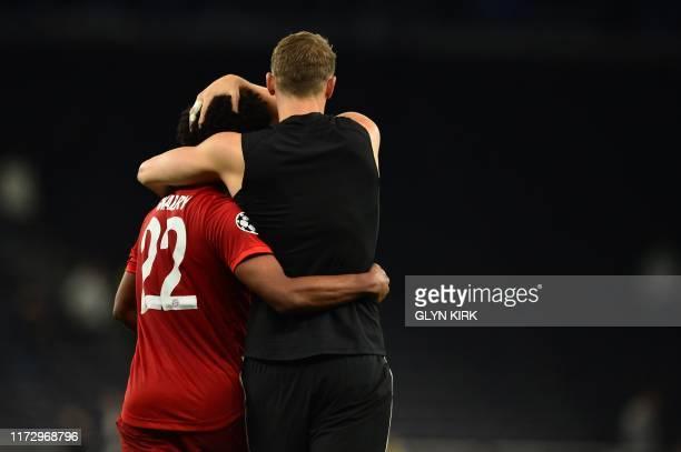 TOPSHOT Bayern Munich's German midfielder Serge Gnabry celebrates with Bayern Munich's German goalkeeper Manuel Neuer on the pitch after the UEFA...
