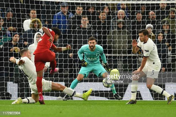 Bayern Munich's German midfielder Serge Gnabry shoots to score their third goal during the UEFA Champions League Group B football match between...
