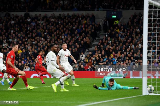Bayern Munich's German midfielder Serge Gnabry turns to celebrate as he scores their fourth goal during the UEFA Champions League Group B football...