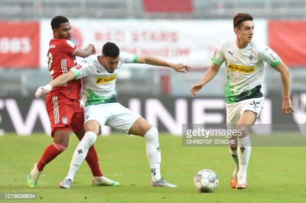 Bayern Munich's German midfielder Serge Gnabry vies with Moenchengladbach's German midfielder Florian Neuhaus and Moenchengladbach's Algerian...