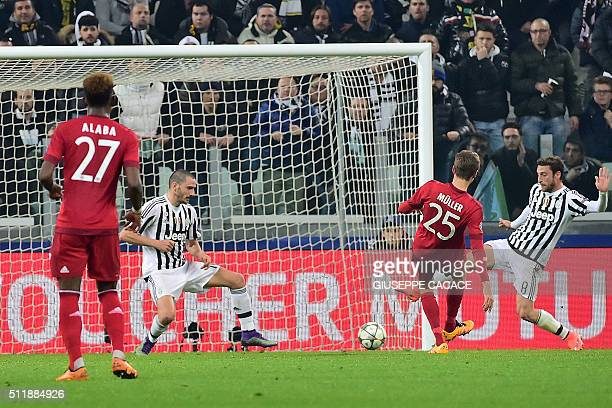 Bayern Munich's German midfielder Thomas Mueller scores a goal during the UEFA Champions League round of 16 first leg football match between Juventus...