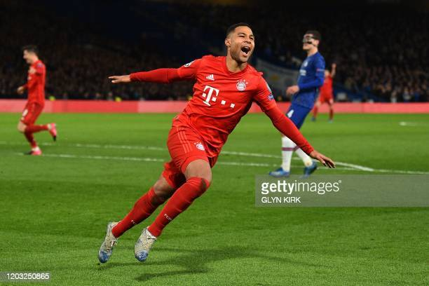 Bayern Munich's German striker Serge Gnabry celebrates after scoring their second goal during the UEFA Champion's League round of 16 first leg...