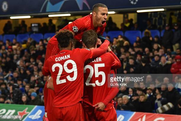 Bayern Munich's German striker Serge Gnabry celebrates with teammates after scoring their second goal during the UEFA Champion's League round of 16...